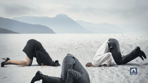 Business people burying their head in the sand to avoid marketing