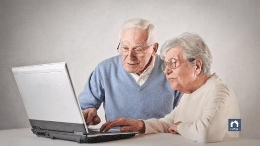 Elderly couple exploring home improvement solutions online