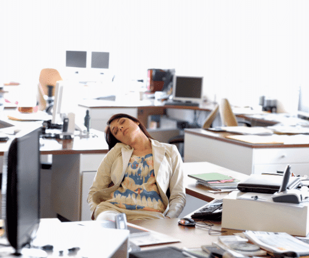 office worker asleep. Image to demonstrate that a website without optimisation is like a useless employee